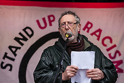 London, UK. 16th March, 2019. Author Michael Rosen addresses thousands of people on the March Against Racism demonstration on UN Anti-Racism Day against a background of increasing far-right activism around the world and a terror attack yesterday on two mosques in New Zealand by a far-right extremist which left 49 people dead and another 48 injured.