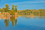 Cottages reflected in Lake of the Woods<br />