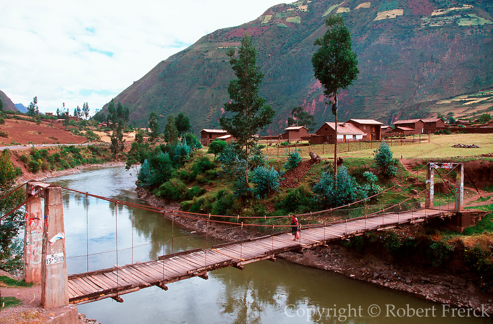 PERU, HIGHLANDS, LANDSCAPE the Sacred Valley of the Incas with a suspension bridge crossing the Urubamba  River outside the town of Huasaq