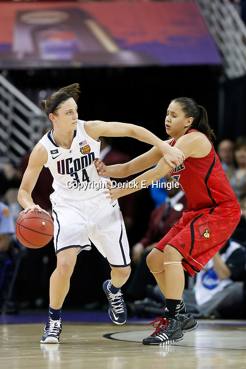 Apr 9, 2013; New Orleans, LA, USA; Connecticut Huskies guard Kelly Faris (34) dribbles against Louisville Cardinals guard Shoni Schimmel (right) during the second half of the championship game in the 2013 NCAA womens Final Four at the New Orleans Arena. Mandatory Credit: Derick E. Hingle-USA TODAY Sports