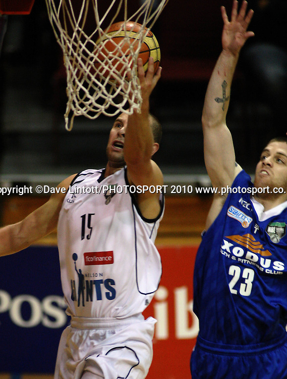 Giants guard Michael Fitchett lays up under pressure from Eric Devendorf.<br /> NBL - Wellington Saints v Nelson Giants at TSB Bank Arena, Wellington. Friday, 21 May 2010. Photo: Dave Lintott/PHOTOSPORT