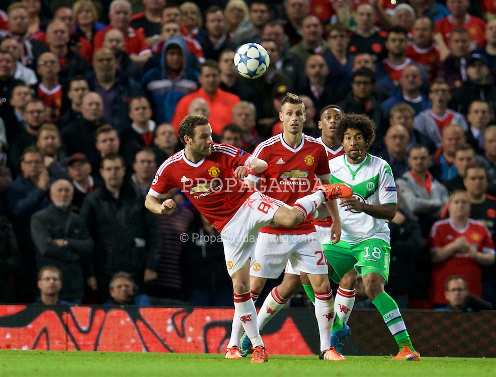 MANCHESTER, ENGLAND - Wednesday, September 30, 2015: Manchester United's Juan Mata flicks the ball on to set-up the second goal against VfL Wolfsburg during the UEFA Champions League Group B match at Old Trafford. (Pic by David Rawcliffe/Propaganda)