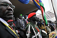 Government and military officials at the podium just before the raising of the new flag for the Republic of South Sudan during the official independence day ceremony. After decades of conflict, Southern Sudan declared independence from the North on July 9th, 2011. Government officials, foreign dignitaries and ordinary people came to the John Garang Memorial in the capital from all over the country and the world to celebrate the historic occation..Juba, South Sudan. 09/07/2011..Photo © J.B. Russell
