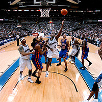10 March 2007:   Washington Wizards guard Gilbert Arenas (0) drives to the basket and scores 2 of his team high 25 points in the second half against New York Knicks forward Renaldo Balkman (L) at the Verizon Center in Washington, D.C.  The Knicks defeated the Wizards 90-89.