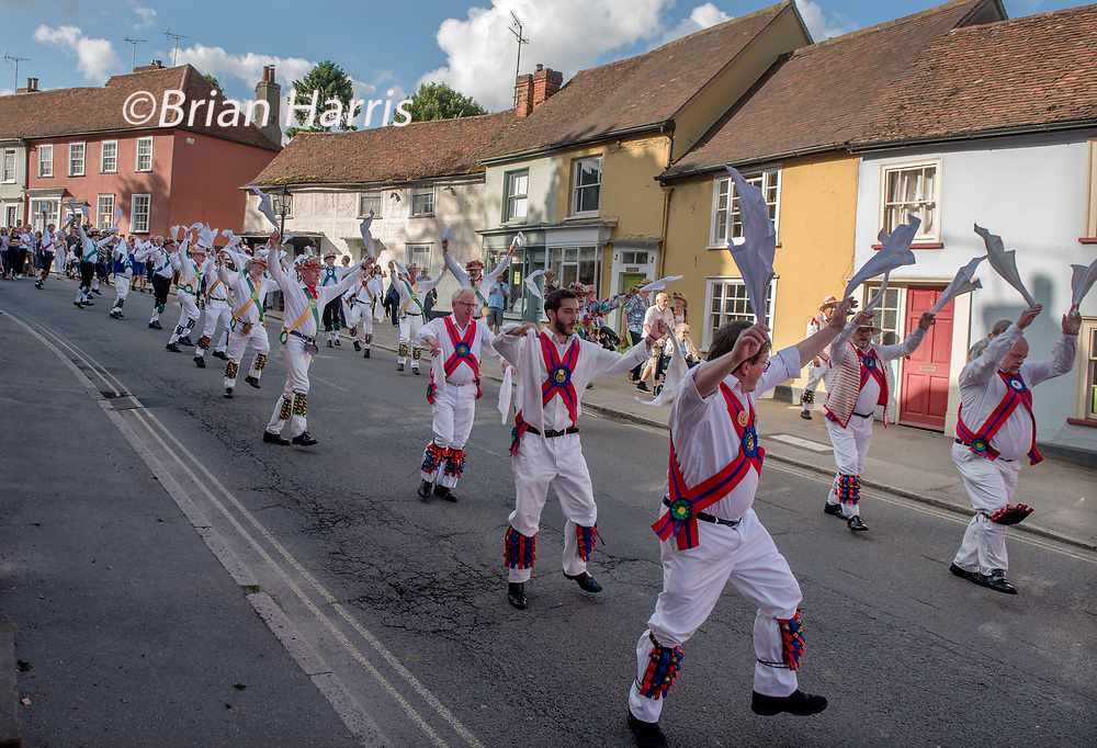 Thaxted Morris Weekend, Thaxted Essex England UK. 2-3 June 2018<br /> The 85th Meeting of the Member Clubs of the Morris Ring hosted by Thaxted Morris Men (who wear red and white stripes) who lead the Saturday evening procession to Town Street in Thaxted after a busy day of dancing in a dozen local pubs in surrounding villages in North West Essex. The Chalice side lead Lincoln and Micklebarrow side.