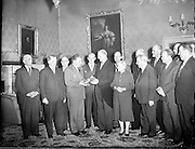 Members of the Government, including An Taoiseach Seán Lemass, visit President and Mrs. de Valera at Áras an Uachtarain on the occasion of their Golden Jubilee, and present them with a 150 year old silver salver and a portrait.  .08.01.1960