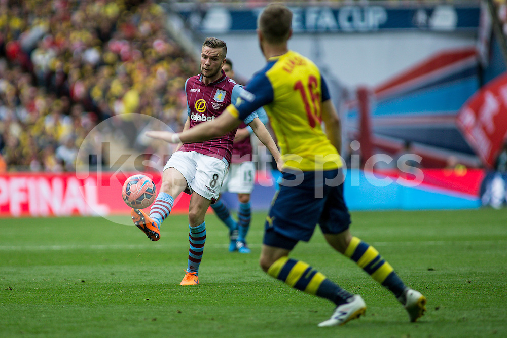 Tom Cleverley of Aston Villa clips the ball forward during the The FA Cup Final match between Arsenal and Aston Villa at Wembley Stadium, London, England on 30 May 2015. Photo by Liam McAvoy.