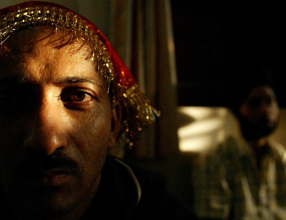 Light bathes on a man in a sikh temple in Delhi, India