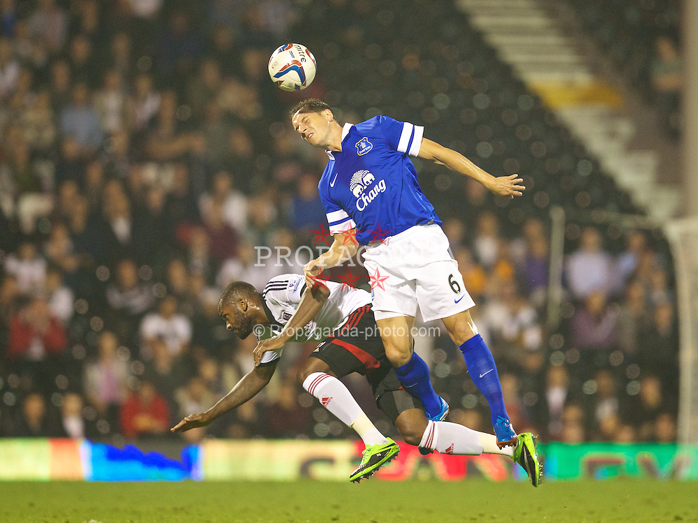 LONDON, ENGLAND - Tuesday, September 24, 2013: Everton's captain Phil Jagielka in action against Fulham's Darren Bent during the Football League Cup 3rd Round match at Craven Cottage. (Pic by David Rawcliffe/Propaganda)