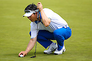 Korean golf professional Y E Yang lines up his putt during the BMW PGA Championship at the Wentworth Club, Virginia Water, United Kingdom on 28 May 2016. Photo by Simon Davies.