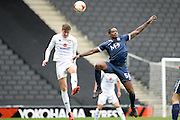 Milton Keynes Dons defender (on loan from Wigan Athletic) Jack Hendry (16) heads the ball under pressure from Southend United striker  Nile Ranger (50)  during the EFL Sky Bet League 1 match between Milton Keynes Dons and Southend United at stadium:mk, Milton Keynes, England on 22 October 2016. Photo by Dennis Goodwin.