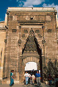 TURKEY, CENTRAL ANATOLIA, SIVAS Buruciye Medresesi, C1271 AD;  Sel�uk style school; the entry facade with students from the local university