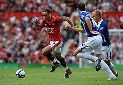 Dimitar Berbatov of Manchester United takes on Sebastian Larsson of Birmingham City during the Barclays Premier League match between Manchester United and Birmingham City at Old Trafford on August 16, 2009 in Manchester, England.