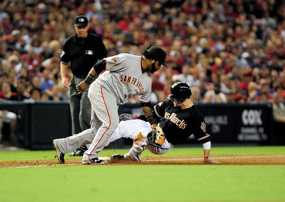 Sep. 24 2011; Phoenix, AZ, USA; San Francisco Giants infielder Pablo Sandoval (48) attempts to tag Arizona Diamondbacks outfielder Collin Cowgill (4) out at third base during the first inning against the Arizona Diamondbacks at Chase Field. The Diamondbacks defeated the Giants 15-2.  Mandatory Credit: Jennifer Stewart-US PRESSWIRE..