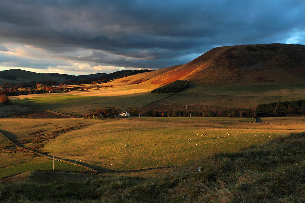 Evening rays of light on an autumnal evening over the hill named 'Trahenna', in the Upper Tweedale region of the Scottish Borders