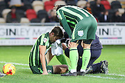 Paul Robinson of AFC Wimbledon receives treatment for his ongoing cut on head during the Sky Bet League 2 match between Newport County and AFC Wimbledon at Rodney Parade, Newport, Wales on 19 December 2015. Photo by Stuart Butcher.