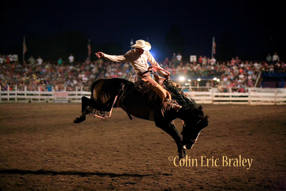 "Riders participate in the 74th ""That Famous Preston Night"" Rodeo in Preston Idaho, August 1, 2009. The annual event is billed as one of the region's biggest rodeos, bringing top riders and thousands of fans to the small southern Idaho town. Photo by Colin E. Braley"