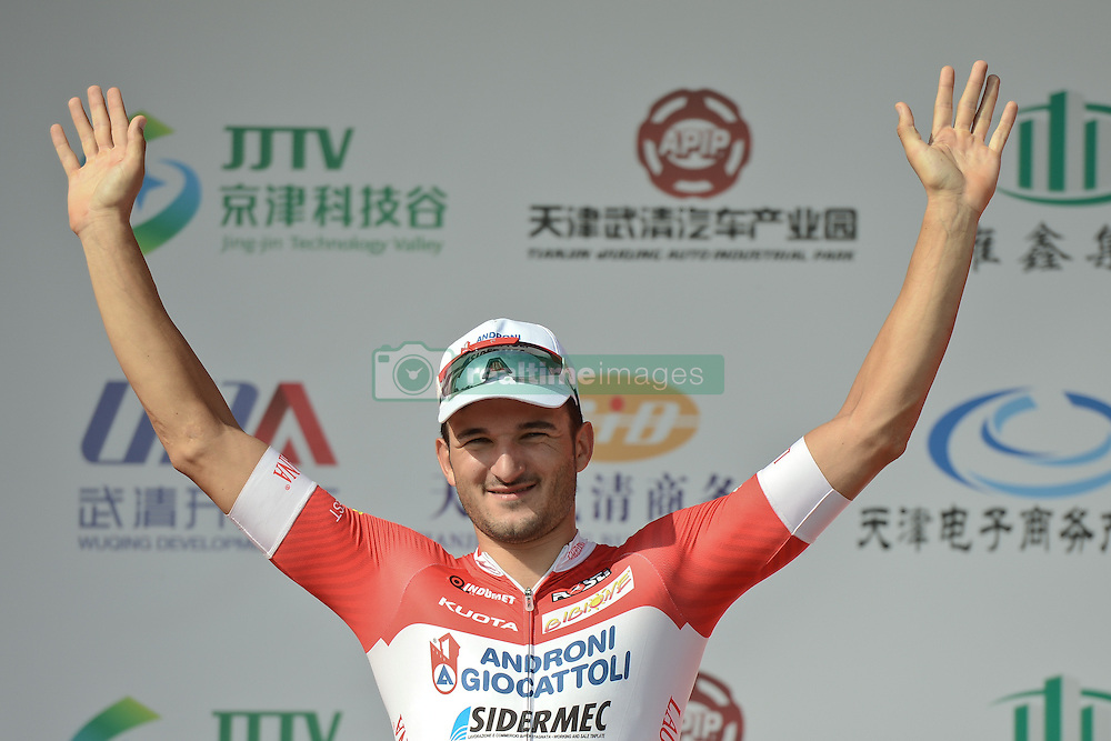 September 9, 2016 - Tianjin, China - Italian Marco Benfatto from Androni-Giocattoli Team wins the opening stage, 109 km on Tianjin Wuqing circuit, of the 2016 Tour of China 1..Wuqing district of Tianjin, the fourth largest city in China, is located in the core of Jingjinji economical circle, also known as Beijing-Tianjin-Hebei, the national capital region region of China, with a distance of 71km from Beijing. .Wuqing, as the national ecological demonstration zone, is largely covered by trees (average 36.4%), and 11 national first and second class rivers, including Beiyun, Longfeng and Yongding river are crossing here. The region also attracted over 250 large firms and corporations listed in Fortune 500 companies..On Friday, 9 September 2016, in Tianjin, China. (Credit Image: © Artur Widak/NurPhoto via ZUMA Press)