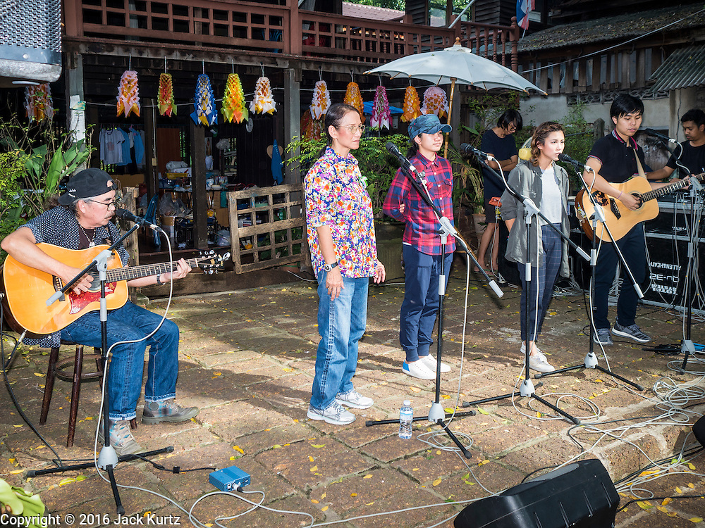 10 SEPTEMBER 2016 - BANGKOK, THAILAND: Musicians perform during a community celebration in Pom Mahakan. Forty-four families still live in the Pom Mahakan Fort community. The city of Bangkok has given them provisional permission to stay, but city officials say the permission could be rescinded and the city go ahead with the evictions. The residents of the historic fort have barricaded most of the gates into the fort and are joined every day by community activists from around Bangkok who support their efforts to stay.                PHOTO BY JACK KURTZ