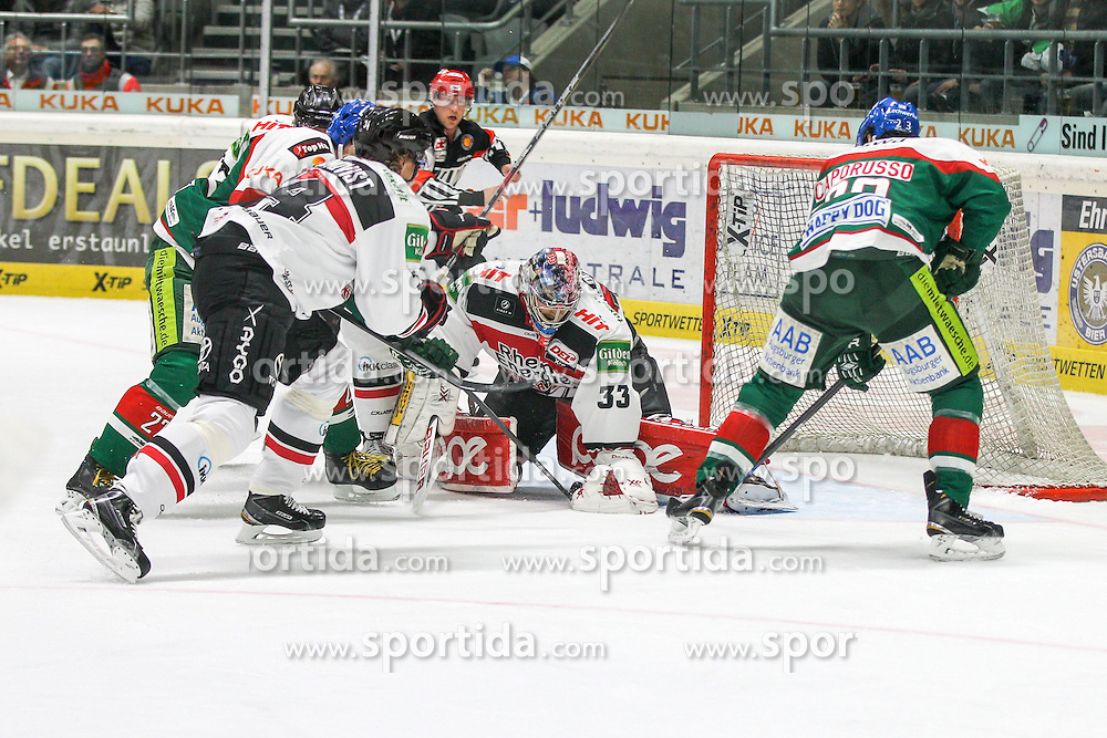 12.12.2014, Curt Fenzel Stadion, Augsburg, GER, DEL, Augsburger Panther vs Koelner Haie, 26. Runde, im Bild l-r: im Zweikampf, Aktion, mit Ivan Ciernik #27 (Augsburger Panther), Daniel Tjaernqvist #34 (Koelner Haie), Danny aus den Birken #33 (Koelner Haie) und Louie Caporusso #23 (Augsburger Panther) // during Germans DEL Icehockey League 26th round match between Augsburger Panther vs Koelner Haie at the Curt Fenzel Stadion in Augsburg, Germany on 2014/12/12. EXPA Pictures © 2014, PhotoCredit: EXPA/ Eibner-Pressefoto/ Kolbert<br /> <br /> *****ATTENTION - OUT of GER*****
