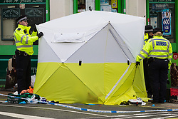 A cordon is in place as a tent covers the body of a man in his 30s who was stabbed outside an off licence in the early hours of Sunday February 10th on Lordship Lane, East Dulwich in London. London, February 10 2019.