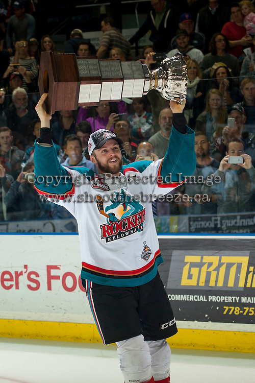 KELOWNA, CANADA - MAY 13: Josh Morrissey #27 of Kelowna Rockets skates with the WHL Championship trophy on May 13, 2015 during game 4 of the WHL final series at Prospera Place in Kelowna, British Columbia, Canada.  (Photo by Marissa Baecker/Shoot the Breeze)  *** Local Caption *** Josh Morrissey;