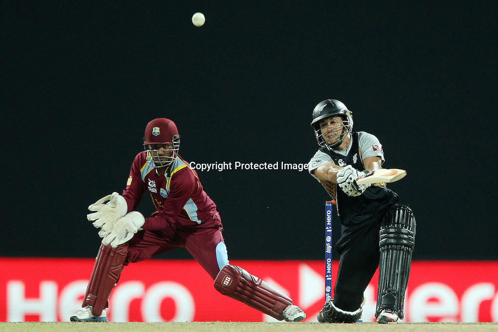 Ross Taylor (Captain) hits out at a delivery from Sunil Narine of The West Indies during the ICC World Twenty20 Super Eights match between The West Indies and New Zealand held at the  Pallekele Stadium in Kandy, Sri Lanka on the 1st October 2012<br /> <br /> Photo by Ron Gaunt/SPORTZPICS/PHOTOSPORT
