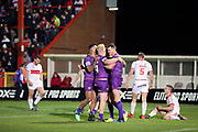 Huddersfield Giants half back Lee Gaskell (6) scores his second try to make it 0-8  and celebrates with team mates during the Betfred Super League match between Hull Kingston Rovers and Huddersfield Giants at the Hull College Craven Park  Stadium, Hull, United Kingdom on 21 February 2020.