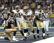New Orleans wide receiver Joe Horn (87) celebrates after scoring a fourth quarter touchdown along with teammates Donte' Stallworth (83) and Boo Williams (82).  The Saints defeated the Rams in overtime 28-25 in St. Louis, Missouri, Sept. 26, 2004.