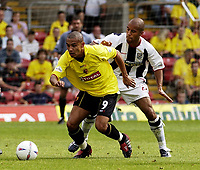 Copyright Sportsbeat Images. 0208 8768611<br />Picture: Henry Browne<br />Date: 23/08/2003<br />Watford v West Bromwich Albion Nationwide First Division<br />Danny Webber of Watford is pursued by James Chambers of West Brom