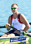 Varese,  ITALY. 2012 FISA European Championships, Lake Varese Regatta Course. ..GBR M4X. John COLLINS, at the start of their heat of the Men's Quadruple Sculls Four...{TIME  {DOW}  14/09/2012.....[Mandatory Credit Peter Spurrier:  Intersport Images]  ..2012 European Rowing Championships ..Rowing, European,  2012 010755.jpg....