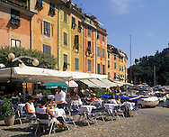 People sitting in an outdoor cafe in Portofino<br /> Harbour, Liguria, Italy