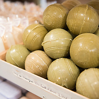 Soaps shaped like petanque balls on display at 72% Petanque, a soap shop located in the Panier neighborhood of Marseille, France.