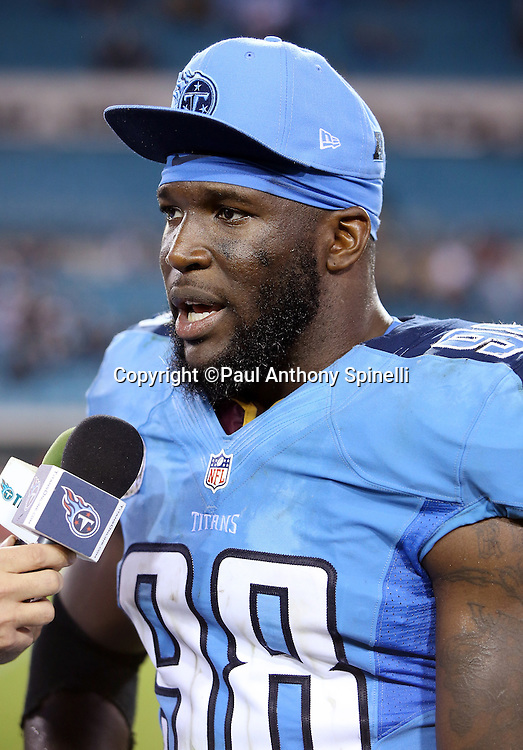 Tennessee Titans outside linebacker Brian Orakpo (98) does a postgame interview after the 2015 week 11 regular season NFL football game against the Jacksonville Jaguars on Thursday, Nov. 19, 2015 in Jacksonville, Fla. The Jaguars won the game 19-13. (©Paul Anthony Spinelli)