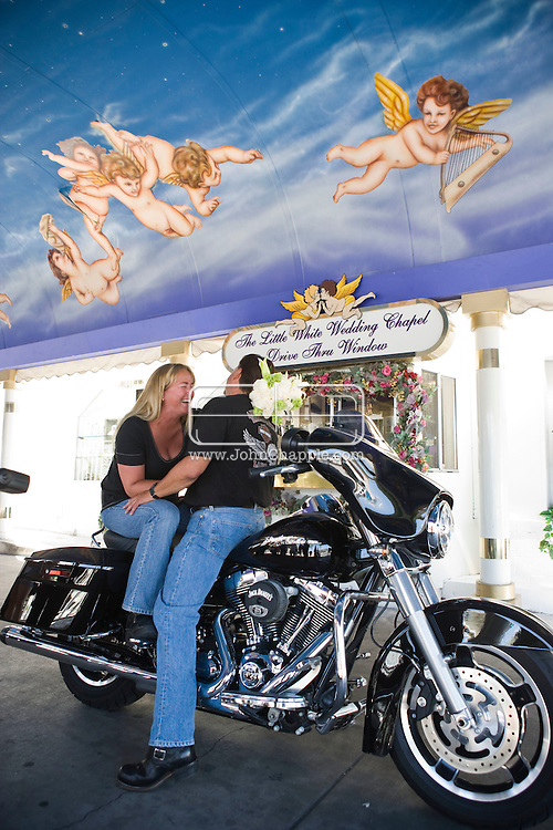 5th June 2010. Las Vegas, Nevada. Known around the world as one of the most Famous places to be married, The Little White Wedding Chapel in Las Vegas has wed stars from Britney Spears to Judy Garland. Pictured is aHarley Davidson drive through weddings, Jim Burrows, 50 and Shannon Miller, 40 from Valencia, CA,. PHOTO © JOHN CHAPPLE / www.chapple.biz.john@chapple.biz  (001) 310 570 9100.
