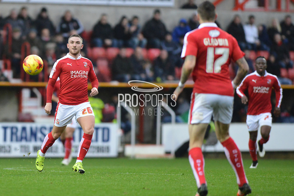 Swindon Town midfielder Anton Rodgers passes the ball during the Sky Bet League 1 match between Swindon Town and Scunthorpe United at the County Ground, Swindon, England on 14 November 2015. Photo by Mark Davies.