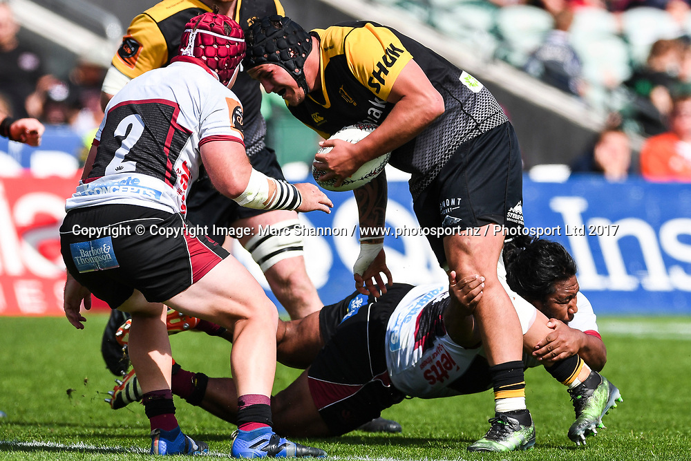 Taranaki Jared Proffit is tackled during a match against North Harbour.<br /> North Harbour v Taranaki, Mitre 10 Cup Rugby, QBE Stadium, Auckland, New Zealand. 15 October 2017. &copy; Copyright Image: Marc Shannon / www.photosport.nz.