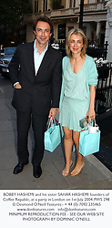BOBBY HASHEMI and his sister SAHAR HASHEMI founders of Coffee Republic, at a party in London on 1st July 2004.PWS 298
