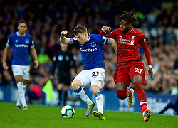 LIVERPOOL, ENGLAND - Sunday, March 3, 2019: Liverpool's Divock Origi (R) and Everton's captain Seamus Coleman during the FA Premier League match between Everton FC and Liverpool FC, the 233rd Merseyside Derby, at Goodison Park. (Pic by Paul Greenwood/Propaganda)
