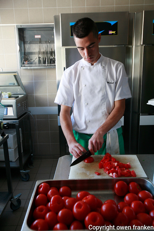 Restaurant Bras, Laguiole, in the Aubrac region, France..Preparation and eating of the staff meal