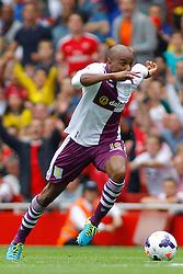 Aston Villa's Fabian Delph runs with the ball  - Photo mandatory by-line: Mitch Gunn/JMP - Tel: Mobile: 07966 386802 17/08/2013 - SPORT - FOOTBALL - Emirates Stadium - London -  Arsenal V Aston Villa - Barclays Premier League