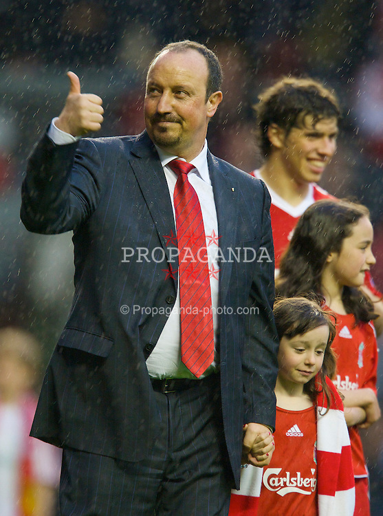 LIVERPOOL, ENGLAND - Sunday, May 4, 2008: Liverpool's manager Rafael Benitez with his daughter Agata during the players' lap-of-honour following the final Premiership match of the season at Anfield. (Photo by David Rawcliffe/Propaganda)