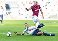 Football - 2018 / 2019 Premier League - West Ham United vs. Tottenham Hotspur<br /> <br /> Toby Alderweireld (Tottenham FC) times his tackle on Marko Arnautovic (West Ham United) as the West Ham forward moves towards goal at the London Stadium<br /> <br /> COLORSPORT/DANIEL BEARHAM