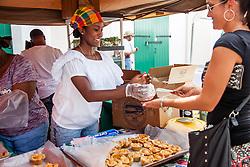 "Felicia Felix sells tarts.  ""Alvin's Cultural Workshop"" Cultural Fair honoring Mr. Alvin Turnbull.  Emancipation Garden.  St. Thomas, VI.  29 April 2015.  © Aisha-Zakiya Boyd"