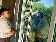 01 OCTOBER 2013 - PHOENIX, AZ:  A man reads the note on the door of the Social Security Administration in Phoenix on the first day of the government shutdown. The US government closed most non-essential federal services Tuesday. The shutdown is be the first in the US in 17 years. More than 700,000 federal government workers could be sent home on unpaid leave, with no guarantee of back pay once the deadlock is over.    PHOTO BY JACK KURTZ