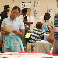 A small crowd gathered early around the different vendor booths set up for the homeless job fair at All Saints Episcopal Church in Tupelo Thursday morning.