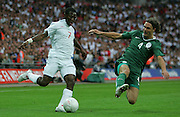 Shaun Wright-Phillips and Marko Suler during the international friendly match between England and Slovenia at Wembley Stadium, London on the 5th September 2009