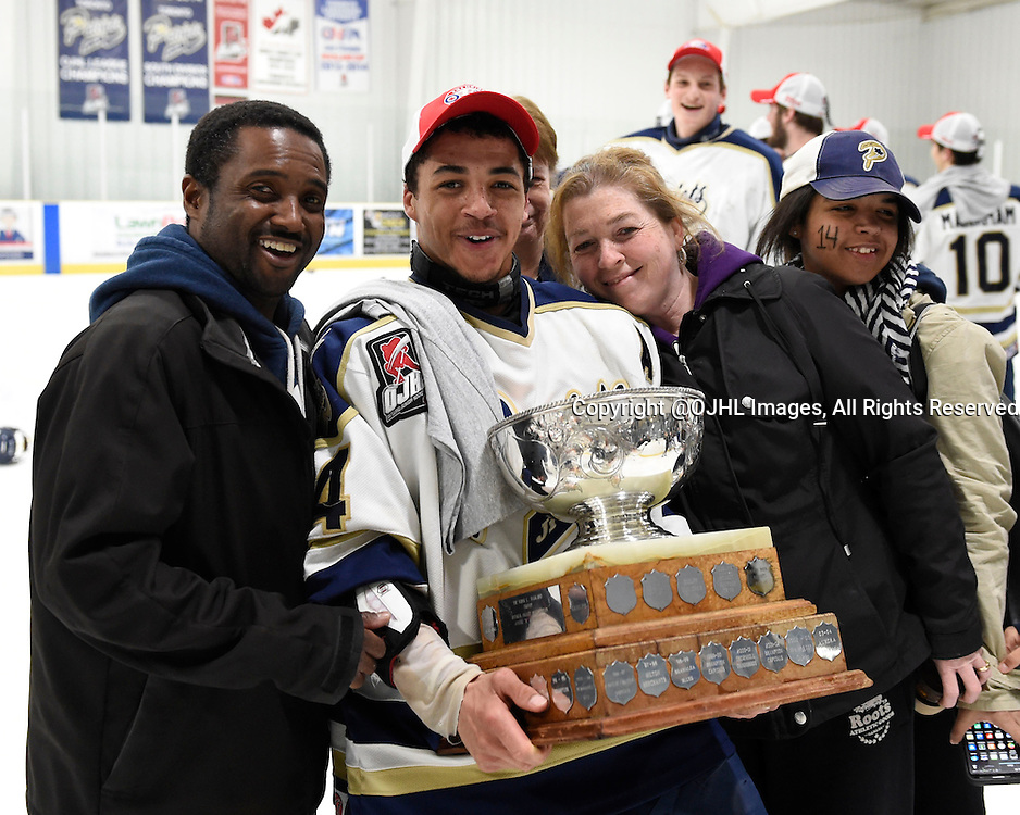TORONTO, ON - Apr 22, 2015 : Ontario Junior Hockey League game action between the Toronto Patriots and the Kingston Voyaguers. Game seven of the Buckland Cup Championship Series. Marcus Rose #14 and his parents celebrate with the Buckland Cup.<br /> (Photo by Andy Corneau / OJHL Images)