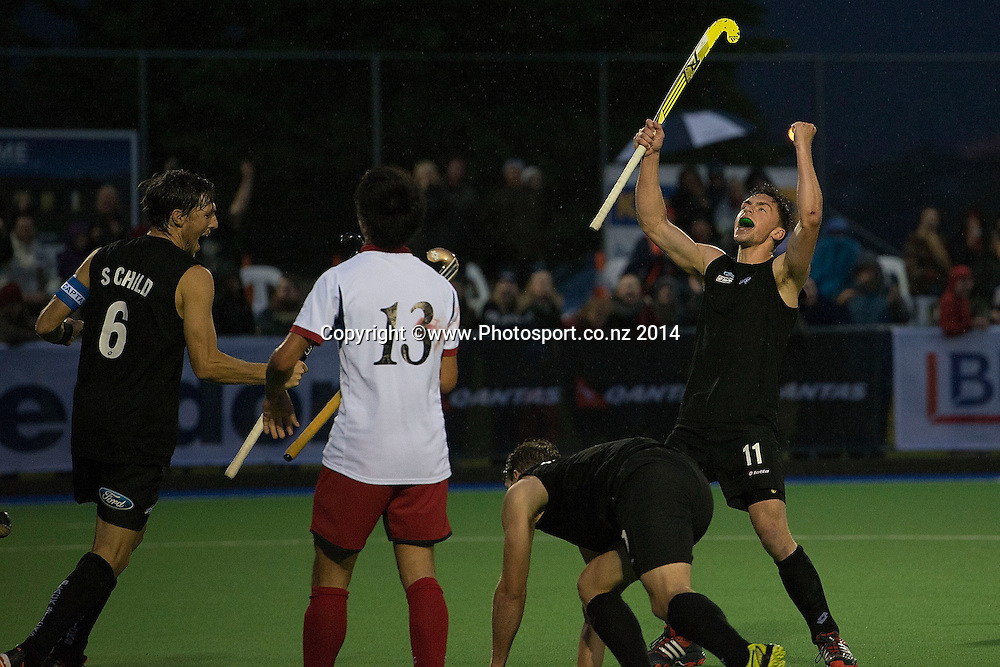 Jake Smith (R and captain Simon Child (L) of New Zealand celebrate team mate Steve Edwards (Bottom) goal during the Black Sticks Men v Japan international hockey match at the Coastlands Kapiti Sports Turf in Paraparaumu on Friday the 21st of November 2014. Photo by Marty Melville/www.Photosport.co.nz