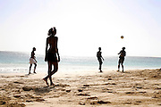 Young people playing football in Vila do Maio beach. The beach is located  just in front of the capital village and is the most accessible and, at the sime time, the most famous postcard image from Maio island. Still little known to tourists, the island can become has great touristical potential with its pristine yellow sand beaches and turquoise water.